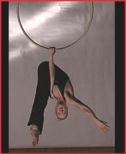 Arch in the Sky - aerialist with hoops