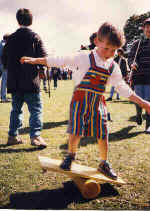 A budding young circus performer tries out a rola bola at a Kris Katchit Circus Workshop.