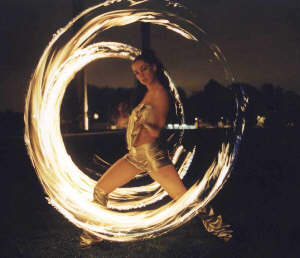Amazing circular fire patterns created with fire poi.