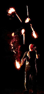 Halloween juggler with 5 fire torches from circusperformers.co.uk and aurorascarnival.co.uk