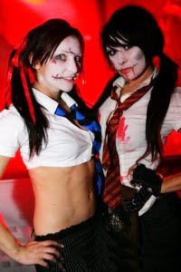 Dead Schoolgirls - stiltwalkers for clubs etc from circusperformers.co.uk and aurorascarnival.co.uk