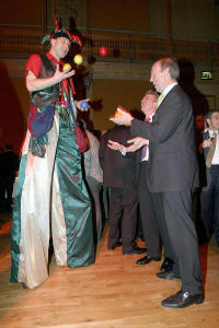 Jack Green juggling on stilts at a corporate event