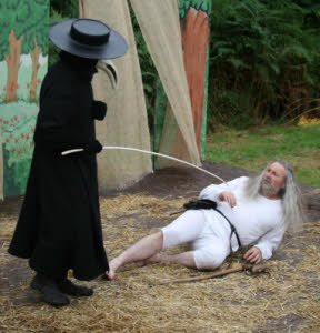 Stage production Plague Doctor and victim