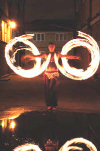 Miss Trixsta Fire circles with fire poi