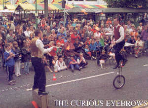Winston & Stuart, The Curious Eyebrows entertain a huge crowd during one of their street shows.