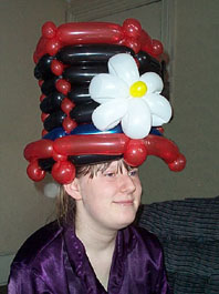 A Fuzzy balloon hat - one of many amazing models which he makes.