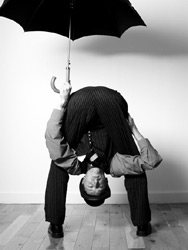 Contortionist Rubber Ritchie shelters from the rain!