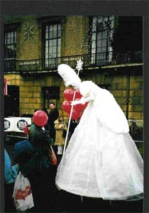 Tamsin the stiltwalking Christmas Fairy chats to the public  from circusperformers.co.uk and Auroras Carnival